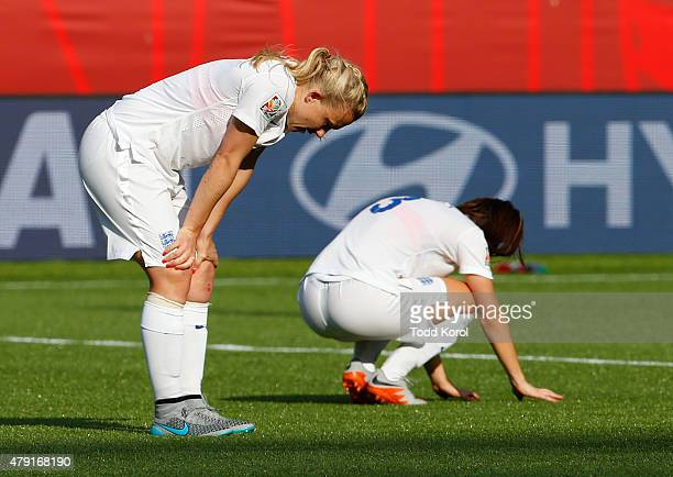 Laura Bassett and Claire Rafferty of England react after a pass by Bassett scored a goal and a win for Japan during the FIFA Women's World Cup Canada...