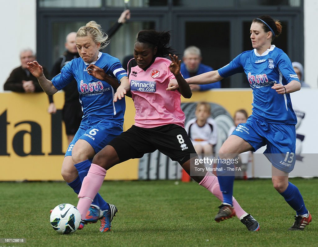 <a gi-track='captionPersonalityLinkClicked' href=/galleries/search?phrase=Laura+Bassett&family=editorial&specificpeople=5984733 ng-click='$event.stopPropagation()'>Laura Bassett</a> of Birmingham City (L) and Precious Hamilton of Lincoln Ladies battle for the ball during the FA Women's Super League match between Birmingham City Ladies FC and Lincoln Ladies FC at DCS Stadium, Stratford Town FC on April 21, 2013 in Stratford, England.