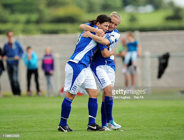 Laura Bassett of Birmingham congratulates her teammate Rachel Williams after she scored their side's third goal during the FA WSL match between...