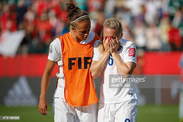 Laura Bassett of England is comforted by Jo Potter after the FIFA Women's World Cup Semi Final match between Japan and England at the Commonwealth...