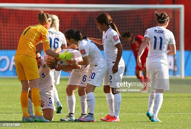 Laura Bassett of England is comforted by team mates after the FIFA Women's World Cup Semi Final match between Japan and England at the Commonwealth...
