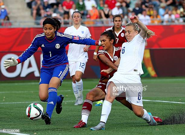 Laura Bassett of England is unable to get the ball past Valeria Miranda and Cecilia Santiago of Mexico during the FIFA Women's World Cup 2015 Group F...
