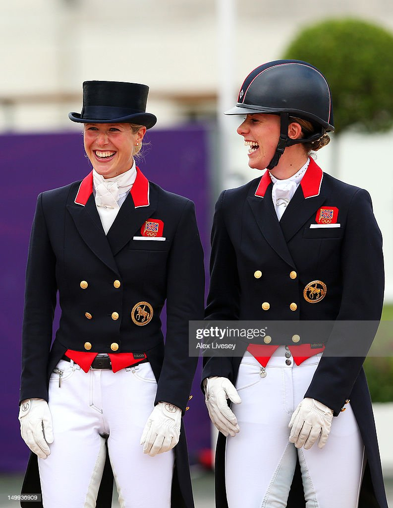 Laura Bechtolsheimer and Charlotte Dujardin of Great Britain celebrate before receiving their gold medals during the medal cerermony for the Team...