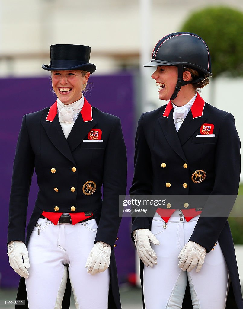 Laura Bechtolsheimer (L) and <a gi-track='captionPersonalityLinkClicked' href=/galleries/search?phrase=Charlotte+Dujardin&family=editorial&specificpeople=5426239 ng-click='$event.stopPropagation()'>Charlotte Dujardin</a> of Great Britain celebrate before receiving their gold medals during the medal cerermony for the Team Dressage on Day 11 of the London 2012 Olympic Games at Greenwich Park on August 7, 2012 in London, England.