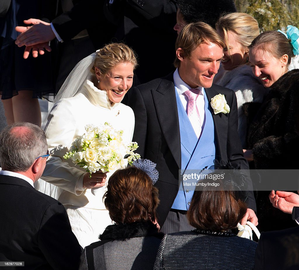 Laura Bechtolsheimer and Mark Tomlinson leave the Protestant Church after their wedding on March 2, 2013 in Arosa, Switzerland.