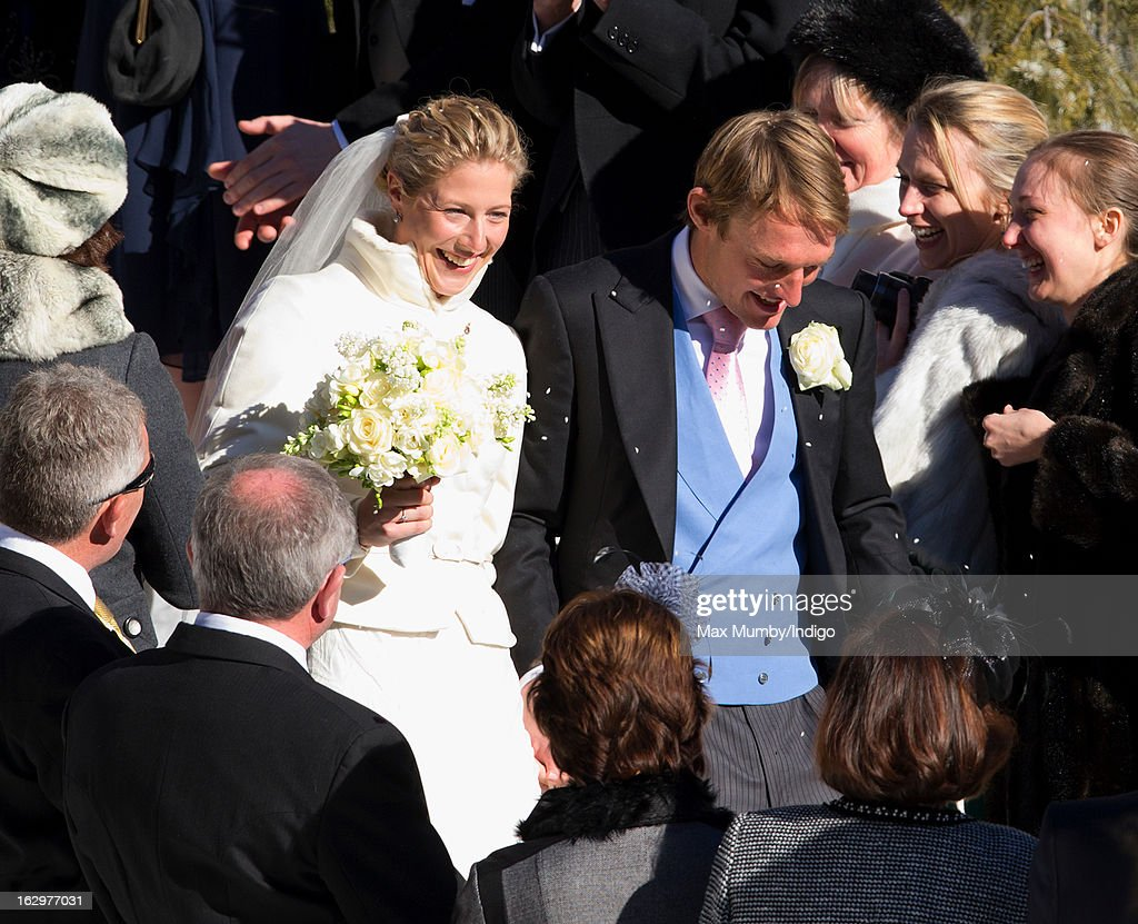 Laura Bechtolsheimer and Mark Tomlinson leave the Protestant Church after their wedding on March 2 2013 in Arosa Switzerland