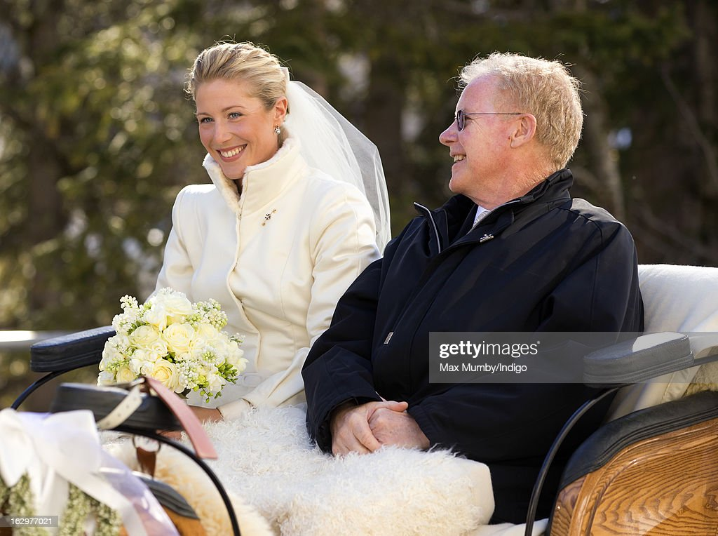 Laura Bechtolsheimer arrives at the Protestant Church in a horse drawn carriage for her wedding to Mark Tomlinson on March 2 2013 in Arosa Switzerland
