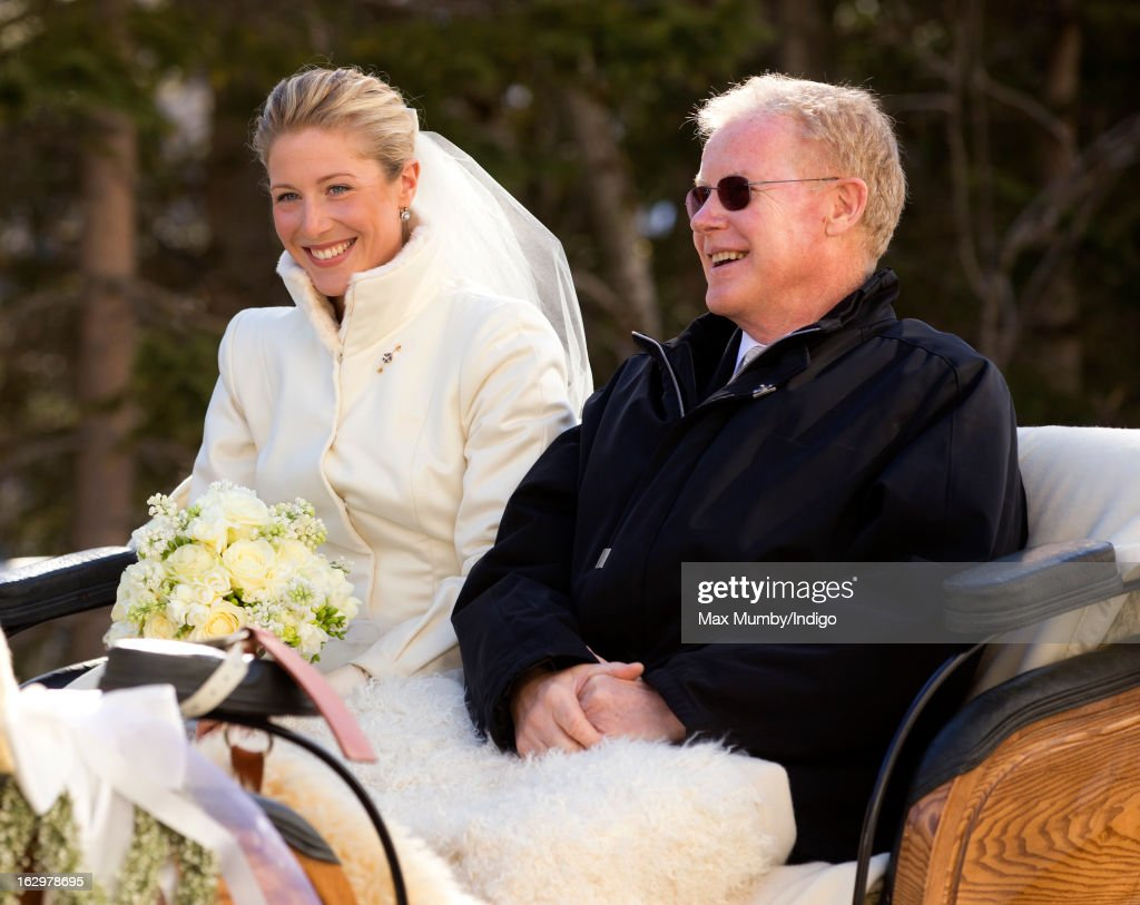 Laura Bechtolsheimer arrives at the Protestant Church in a horse drawn carriage for her wedding to Mark Tomlinson on March 2, 2013 in Arosa, Switzerland.