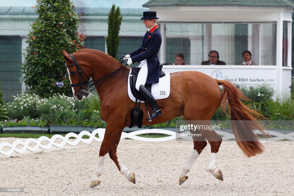 Laura Bechtolsheimer of Great Britain performs on her horse Mistral Hojris during the 'Preis der Teschinkasso' dressage competition at the CHIO on...