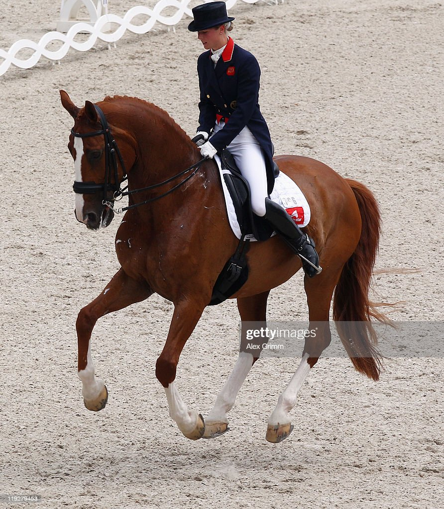 Laura Bechtolsheimer of Great Britain performs on her horse Mistral Hojris during the 'Meggle Preis' Grand Prix Special CDIO dressage competition at...