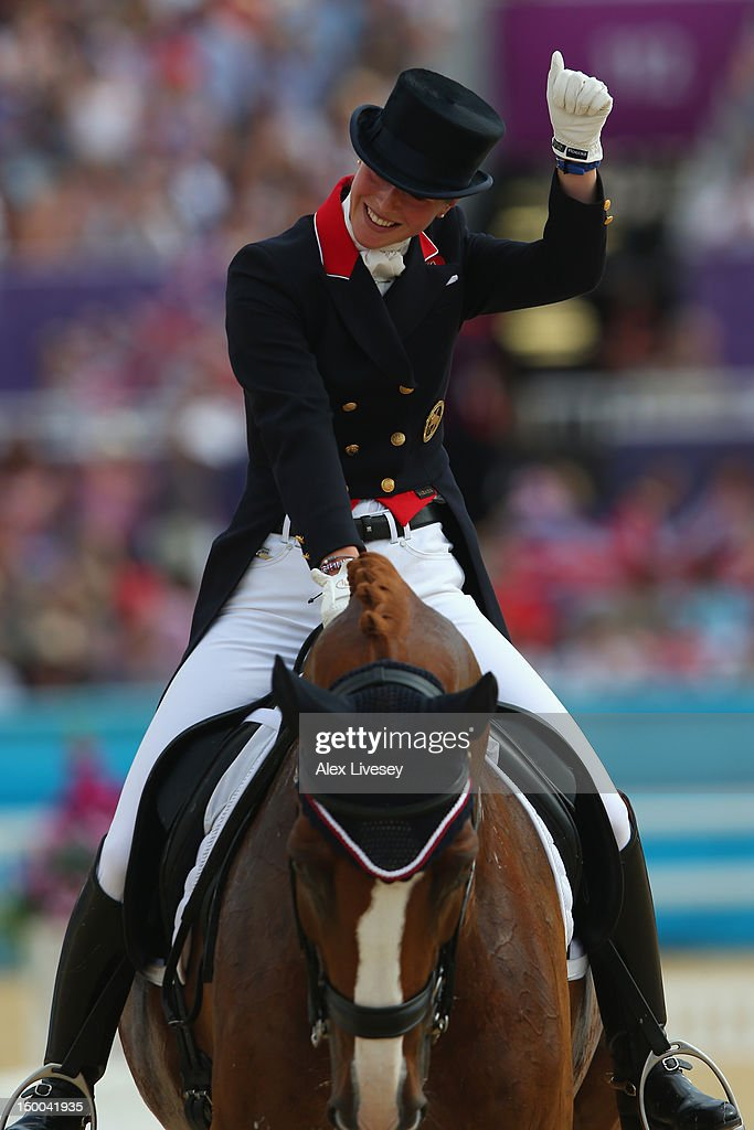 Laura Bechtolsheimer of Great Britain riding Mistral Hojris celebrates during the Individual Dressage on Day 13 of the London 2012 Olympic Games at...