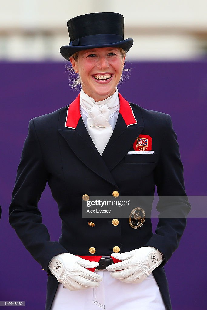 Laura Bechtolsheimer of Great Britain smiles before receiving her gold medal during the medal cerermony for the Team Dressage on Day 11 of the London 2012 Olympic Games at Greenwich Park on August 7, 2012 in London, England.