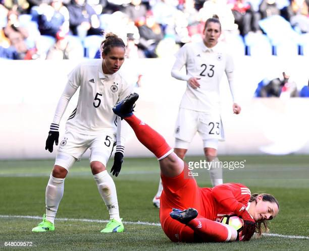 Laura Benkarth of Germany stops a shot as teammate Babett Peter looks on during the second half against France during the SheBelieves Cup at Red Bull...