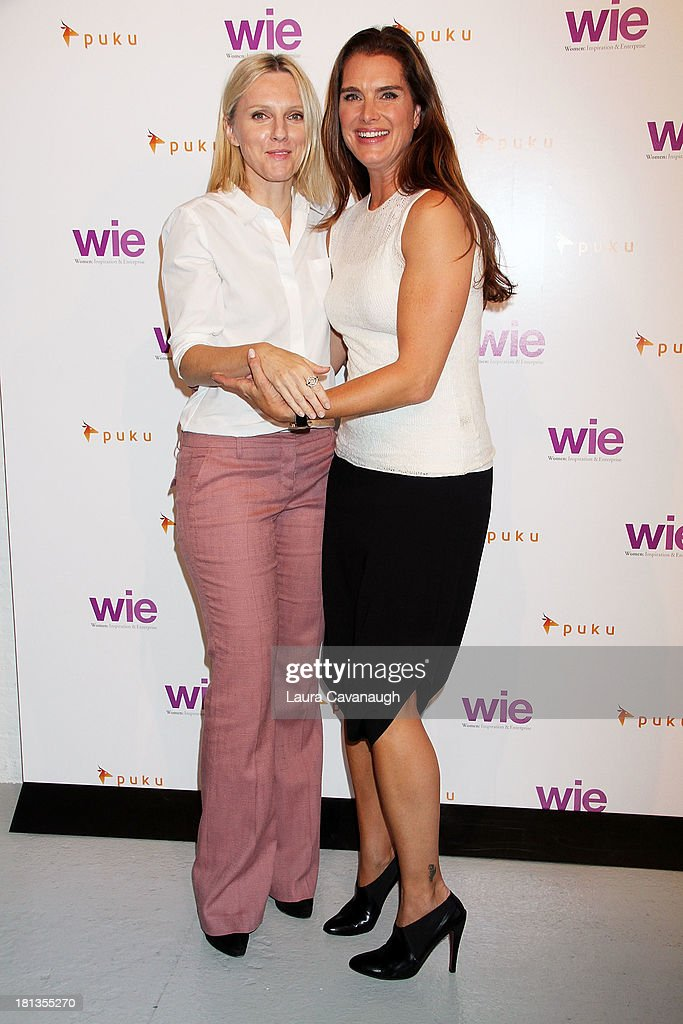 Laura Brown and <a gi-track='captionPersonalityLinkClicked' href=/galleries/search?phrase=Brooke+Shields&family=editorial&specificpeople=202197 ng-click='$event.stopPropagation()'>Brooke Shields</a> attend day 1 of the 4th Annual WIE Symposium at Center 548 on September 20, 2013 in New York City.