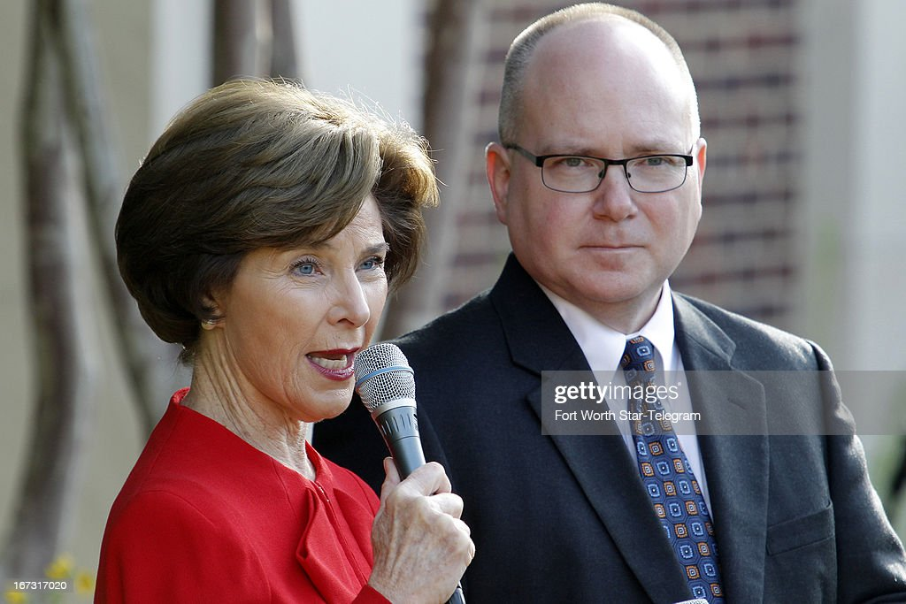 Laura Bush and Alan C. Lowe, Library and Museum Director, talk to the media in the Rose Garden replica. News media outlets were given tours of the new George W. Bush Presidential Library and Museum in Dallas, Texas, Wednesday, April 24, 2013.