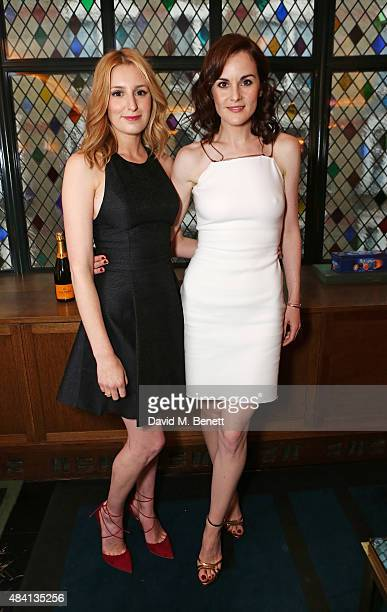 Laura Carmichael and Michelle Dockery attend the Downton Abbey wrap party at The Ivy on August 15 2015 in London England