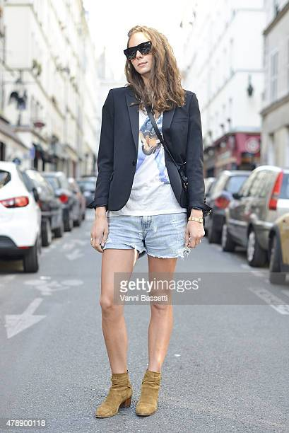 Laura Caseyutz poses wearing Saint Laurent jacket and shoes before the Saint Laurent show at the Carreau du Temple on June 28 2015 in Paris France
