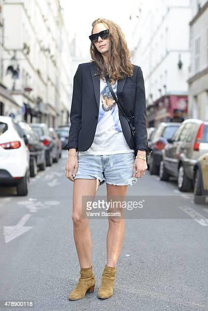 Laura Caseyutz poses wearing Saint Laurent jacket and shoes before the Saint Laurent show at the Carreau du Temple on June 28 2015 in Paris France