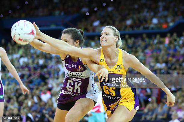 Laura Clemesha of the Firebirds and Caitlin Bassett of the Lightning compete for the ball during round one of the Super Netball match between the...