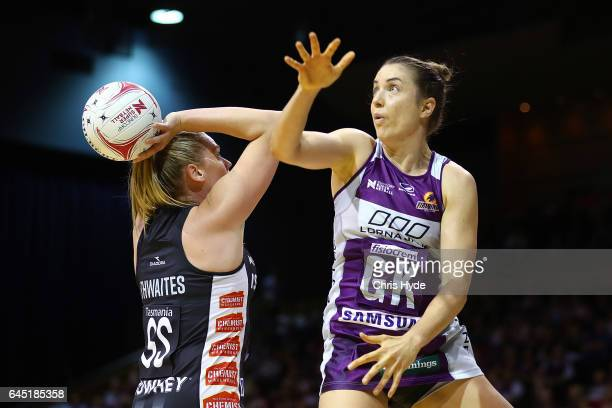 Laura Clemesha of the Firebirds attempts to block Caitlin Thwaites of the Magpies during the round two Super Netball match between the Queensland...