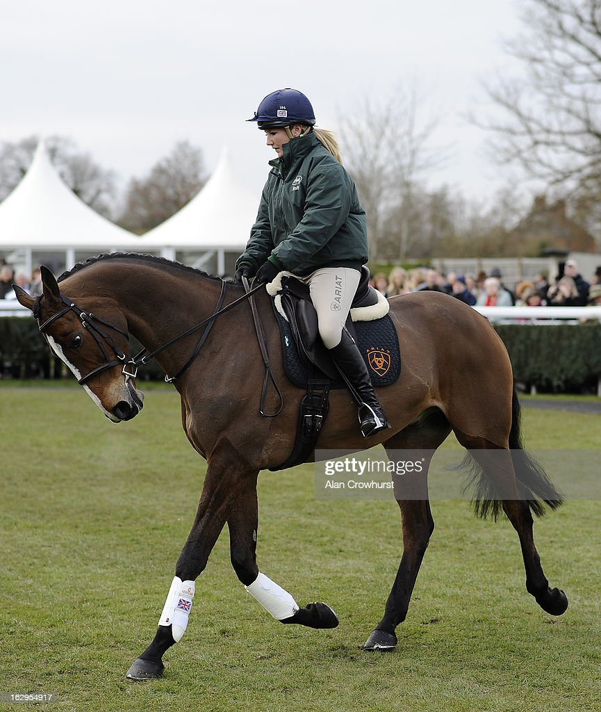 Laura Collett riding Kauto Star carry out a dressage display at Newbury racecourse on March 02, 2013 in Newbury, England.