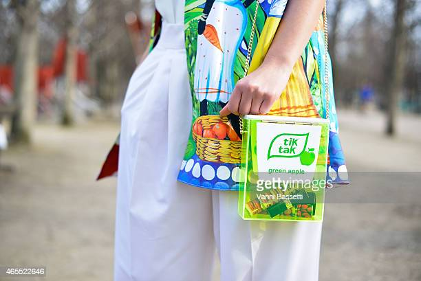 Laura Comolli poses wearing a Stella Jean jacket and Urania Gazelli bag on Day 5 of Paris Fashion Week Womenswear FW15 on March 7 2015 in Paris France
