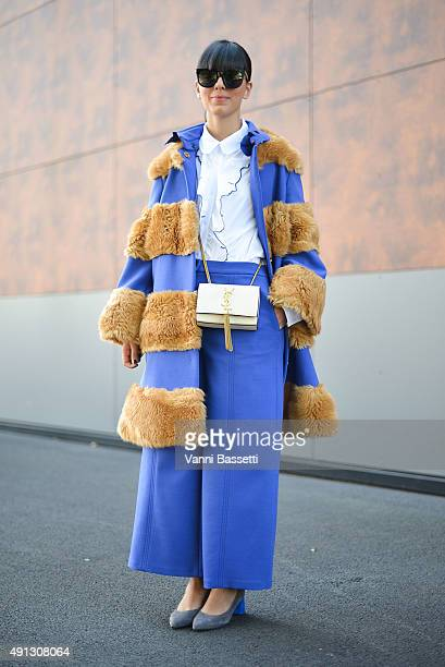 Laura Comolli poses wearing a Vivetta total look and YSL bag after the Kenzo show at the Paris Event Center during Paris Fashion Week SS16 on October...
