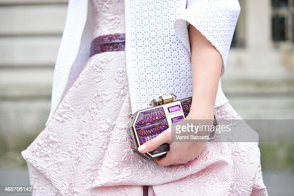 Laura Comolli poses with a Lolita Lorenzo clutch on Day 7 of Paris Fashion Week Womenswear FW15 on March 9 2015 in Paris France