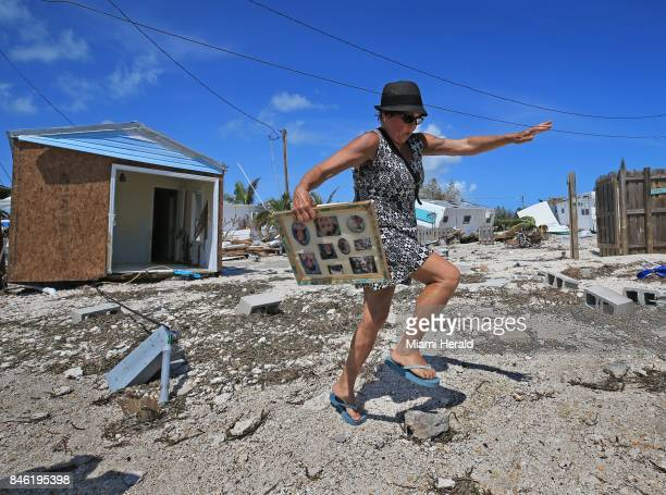 Laura Costello avoids tripping on a rock where her trailer once stood at the Seabreeze trailer park along the Overseas Highway in the Florida Keys on...
