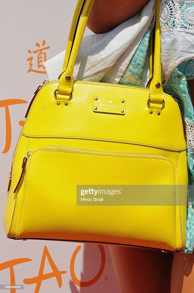 Laura Croft (Kate Spade handbag detail) attends the grand opening season of Tao Beach at the Venetian Hotel and Casino on May 4, 2013 in Las Vegas, Nevada.
