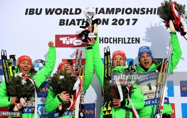 Laura Dahlmeier Franziska Hildebrand Maren Hammerschmidt and Vanessa Hinz of Germany celebrate victory on the podium after the 2017 IBU World...