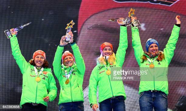 Laura Dahlmeier Franziska Hildebrand Maren Hammerschmidt and Vanessa Hinz of Germany celebrate with their trophies and medals on the podium of the...