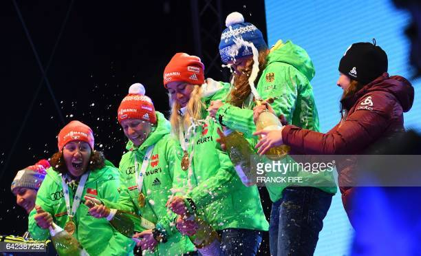 Laura Dahlmeier Franziska Hildebrand Maren Hammerschmidt and Vanessa Hinz of Germany celebrate with champagne on the podium of the 2017 IBU World...