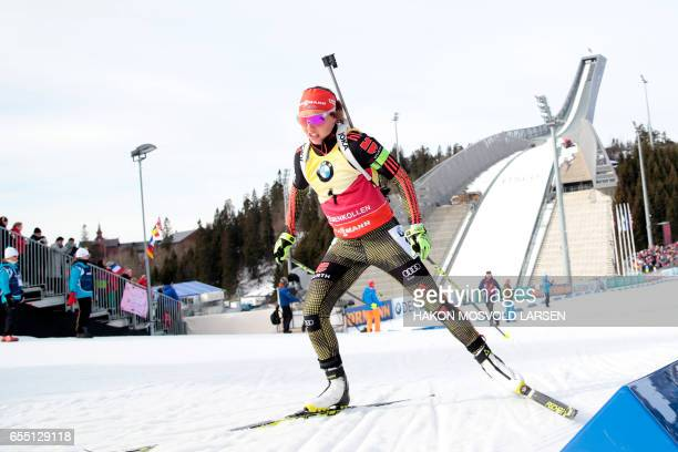 Laura Dahlmeier from Germany competes in IBU Biathlon World Cup Women 125 Mass Start competition during the IBU Biathlon World Cup on March 19 2017...
