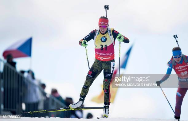 Laura Dahlmeier from Germany competes in the IBU Biathlon World Cup Biathlon Women 10 km pursuit competition in Oslo on March 18 2017 / AFP PHOTO /...