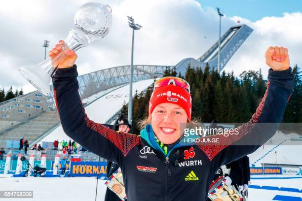 Laura Dahlmeier from Germany holds the trophy for overall victory in the pusuit cup after IBU Biathlon World Cup Biathlon Women 10 km pursuit...