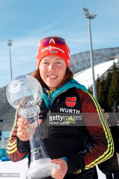 Laura Dahlmeier from Germany poses with the trophy for overall victory in Women IBU Biathlon World Cup in Oslo on March 19 2017 / AFP PHOTO / NTB...