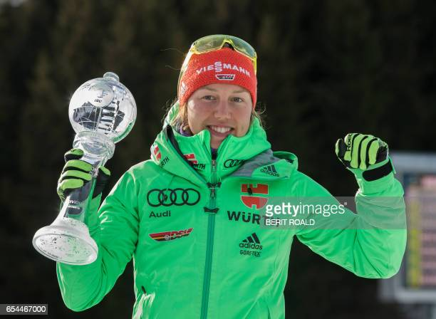 Laura Dahlmeier from Germany with the trophy for overall victory in the women`s world cup after IBU Biathlon World Cup Women 75 km sprint competition...