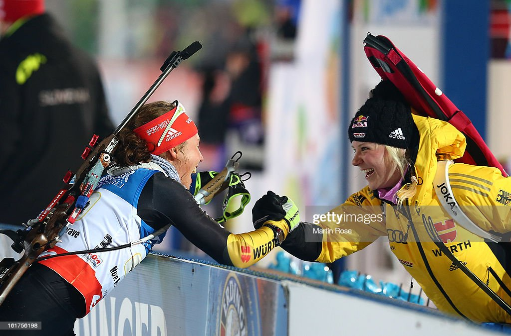 Laura Dahlmeier (L) of Germany celebrate with team mate Miriam Goessner (R) in the Women's 4 x 6km Relay in the IBU Biathlon World Championships at Vysocina Arena on February 15, 2013 in Nove Mesto na Morave, Czech Republic.