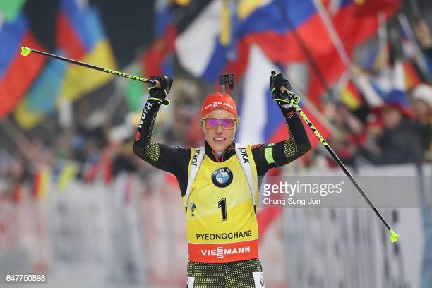 Laura Dahlmeier of Germany celebrates after winning the Woman 10km Pursuit during the BMW IBU World Cup Biathlon 2017 test event for PyeongChang 2018...