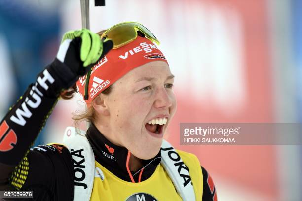 Laura Dahlmeier of Germany celebrates winning the ladies' 10 km pursuit competition at the IBU Biathlon World Cup at Kontiolahti Finland on March 11...