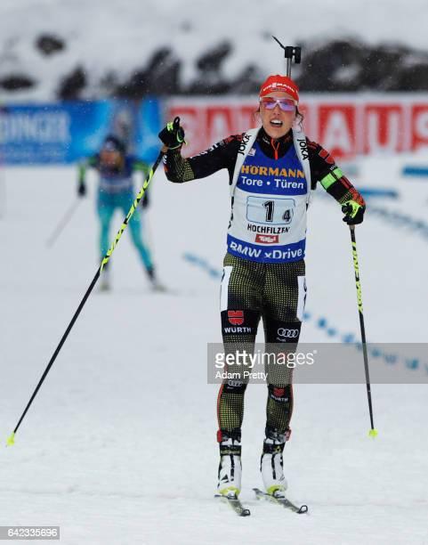 Laura Dahlmeier of Germany crosses the line to claim victory with Vanessa Hinz Maren Hammerschmidt and Franziska Hildebrand of Germany in the Women's...