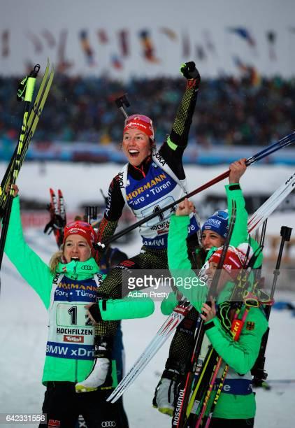 Laura Dahlmeier of Germany is held aloft by her team mates Vanessa Hinz Maren Hammerschmidt and Franziska Hildebrand of Germany after victory in the...