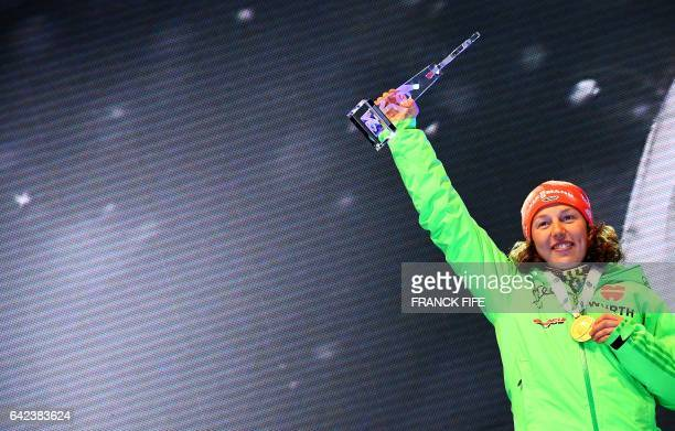 Laura Dahlmeier of Germany poses with the gold medal on the podium of the 2017 IBU World Championships Biathlon Women's x6 km relay competition in...