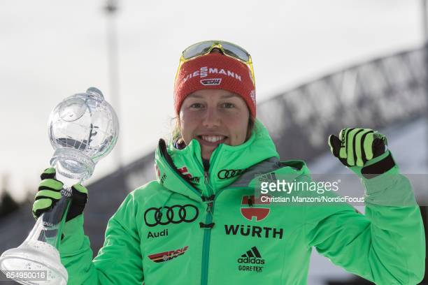 Laura Dahlmeier of Germany presents the cristal globe for the winning of the individual world cup after the 10 km men's Sprint on March 17 2017 in...