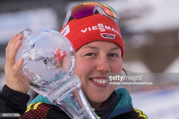 Laura Dahlmeier of Germany presents the cristal globe for winning the pursuit world cup after the 10 km women's Pursuit on March 18 2017 in Oslo...