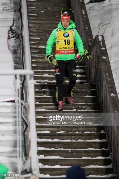 Laura Dahlmeier of Germany walks down the stairs to the flower ceremony after the 75 km women's Sprint on March 2 2017 in Pyeongchanggun South Korea