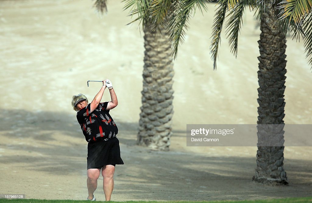 <a gi-track='captionPersonalityLinkClicked' href=/galleries/search?phrase=Laura+Davies&family=editorial&specificpeople=202266 ng-click='$event.stopPropagation()'>Laura Davies</a> of England plays her second shot at the par 4, 14th hole during the final round of the 2012 Omega Dubai Ladies Masters on the Majilis Course at the Emirates Golf Club on December 8, 2012 in Dubai, United Arab Emirates.