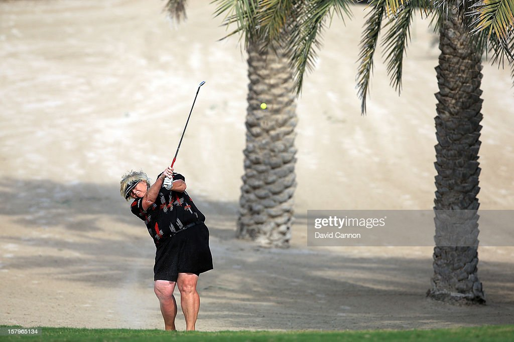 Laura Davies of England plays her second shot at the par 4, 14th hole during the final round of the 2012 Omega Dubai Ladies Masters on the Majilis Course at the Emirates Golf Club on December 8, 2012 in Dubai, United Arab Emirates.