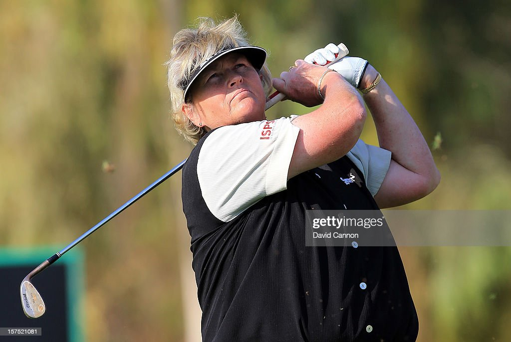<a gi-track='captionPersonalityLinkClicked' href=/galleries/search?phrase=Laura+Davies&family=editorial&specificpeople=202266 ng-click='$event.stopPropagation()'>Laura Davies</a> of England plays her second shot at the par 4, 17th hole during the pro-am as a preview for the 2012 Omega Dubai Ladies Masters on the Majilis Course at the Emirates Golf Club on December 4, 2012 in Dubai, United Arab Emirates.